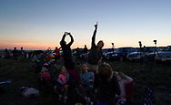 People look at the 360 degree twilight during the total solar eclipse in Guernsey, Wyoming U.S. August 21, 2017.  REUTERS/Rick Wilking