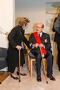 "Movie director Manoel de Oliveira and his wife, in the ceremony where he receives de distinction of ""Grand Officier de la Légion d'Honneur"" by the French Ambassador in Portugal, Jean-François Blarel"