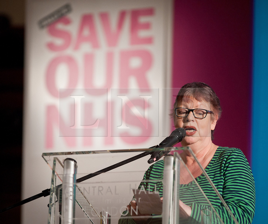 © licensed to London News Pictures. London, UK. 07/03/12. Comedian and ex-mental health nurse Jo Brand speaks at the main rally  in the Methodist Central Hall, Westminster. 'Save our NHS' march & rally in Central London in protest against proposed government changes to the National Health Service. Photo credit: Jules Mattsson/LNP