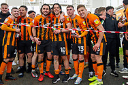 Hull City players gather outside the KCOM stadium to celebrate winning the league 1 title during the EFL Sky Bet League 1 match between Hull City and Wigan Athletic at the KCOM Stadium, Kingston upon Hull, England on 1 May 2021.