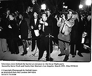 Press behind the barier at entrance to d the Oscar Night party hosted by Steve Tisch and Vanity Fair. Morton's. Los Angeles. March 1995. 95550/23<br />© Copyright Photograph by Dafydd Jones<br />66 Stockwell Park Rd. London SW9 0DA<br />Tel 0171 733 0108
