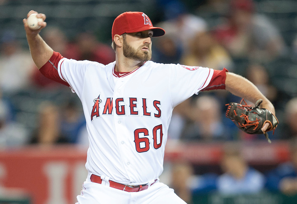 The Angels' A.J. Achter pitches the ninth inning during the Angels' 8-1 victory over the Dodgers Wednesday night at Angel Stadium.<br /> <br /> ///ADDITIONAL INFO:   <br /> <br /> angels.0519.kjs  ---  Photo by KEVIN SULLIVAN / Orange County Register  -- 5/18/16<br /> <br /> The Los Angeles Angels take on the Los Angeles Dodgers in inter-league play at Angel Stadium Wednesday night.