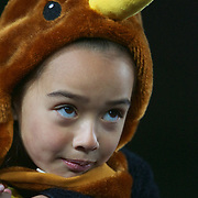A young New Zealand fan sings the National Anthem during the New Zealand V France, Pool A match during the IRB Rugby World Cup tournament. Eden Park, Auckland, New Zealand, 24th September 2011. Photo Tim Clayton....