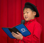 Henry Pu sings the French national anthem during the celebration of Claire Frazier being awarded the Chevalier dans Ordre des Palmes Academiques by France Cultural Attache Sylvie Christophe at Kolter Elementary School, November 20, 2013.