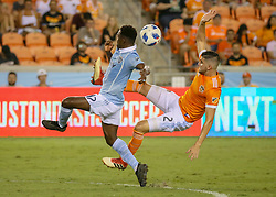July 18, 2018 - Houston, TX, U.S. - HOUSTON, TX - JULY 18:  Houston Dynamo defender Alejandro Fuenmayor (2) kicks the ball away from Sporting Kansas City forward Gerso (12) during the US Open Cup Quarterfinal soccer match between Sporting KC and Houston Dynamo on July 18, 2018 at BBVA Compass Stadium in Houston, Texas. (Photo by Leslie Plaza Johnson/Icon Sportswire) (Credit Image: © Leslie Plaza Johnson/Icon SMI via ZUMA Press)