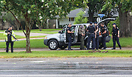 Man with rifle in the back of his car detained across from police station in Baton Rouge, The police stopped him along Airline Highway, the morning six law enforcement officers were shot, three of them killed.