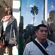 Tourists and pedestrians walk along Hollywood Boulevard in Hollywood, CA.
