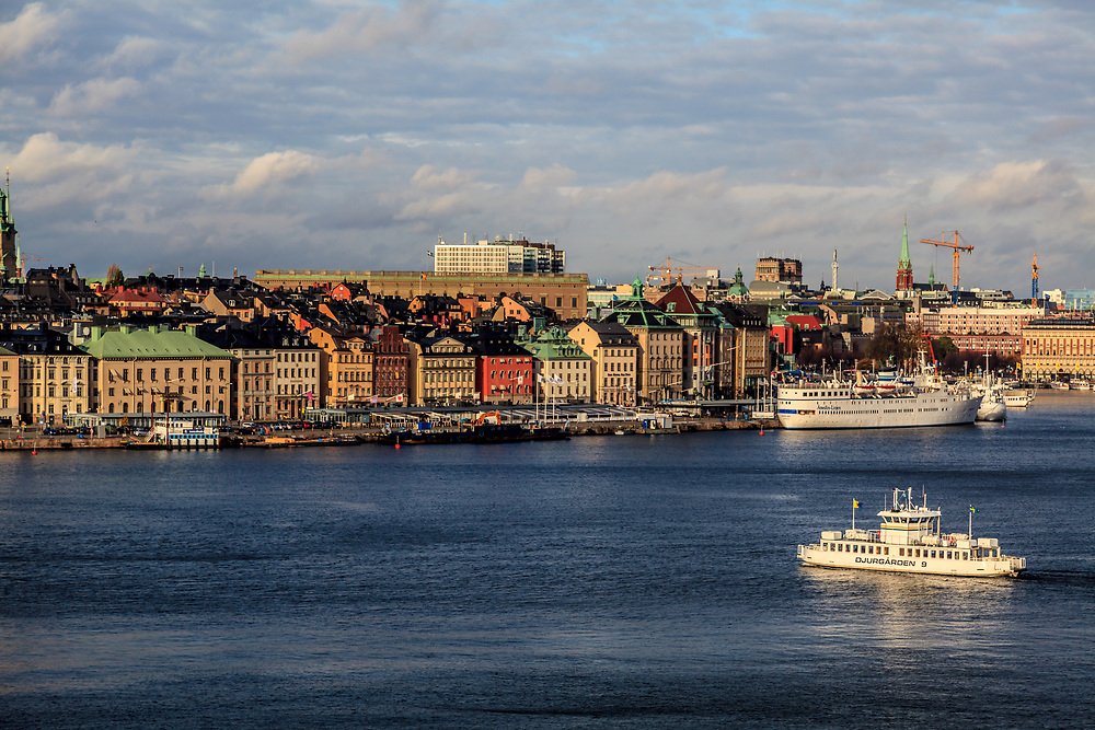 White Djurgården ferry on its way to the Old Town in Stockholm, Sweden. Travelling by local ferries is a fantastic way to experience a city built on islands.