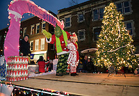 "The ""Who-ville"" float by Bank of New Hampshire waves to the crowd during the annual Holiday Parade through downtown on Saturday evening.  (Karen Bobotas/for the Laconia Daily Sun)"