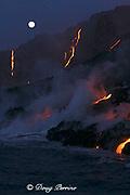 "the full moon shimmers behind heat waves as red hot lava from Kilauea Volcano cascades down a sea cliff in the pre-dawn, Hawaii Volcanoes National Park, Hawaii Island (""the Big Island""), Hawaiian Islands, U.S.A."