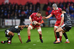 James Davies of Scarlets evades the tackle of Keelan Giles of Ospreys<br /> <br /> Photographer Craig Thomas/Replay Images<br /> <br /> Guinness PRO14 Round 11 - Ospreys v Scarlets - Saturday 22nd December 2018 - Liberty Stadium - Swansea<br /> <br /> World Copyright © Replay Images . All rights reserved. info@replayimages.co.uk - http://replayimages.co.uk