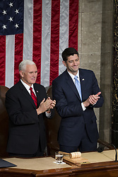 January 30, 2018 - Washington, District Of Columbia, USA - United States Vice President MIKE PENCE, left, and Speaker of the United States House of Representatives PAUL RYAN, Republican of Wisconsin, right, look on as United States President Donald J. Trump delivers the State Of The Union Address at the United States Capitol in Washington, D.C. on January 30, 2018. (Credit Image: © Alex Edelman via ZUMA Wire)