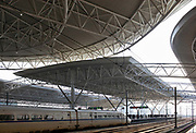 A bullet train pulls into the ultra modern railway station in Kunshan, Jiangsu Province, China on 25 October, 2011. In just a few years, China has built the world's longest high-speed rail network, named China Rail High-speed (CRH), and continues to expand despite accusations of technology pilfering and safety concerns. On July 23rd, 2011, two high-speed trains in eastern China collided due to supposed malfunctioning in the signaling system, killing 40 and injuring hundreds, meanwhile a slew of corruption scandals at China's rail ministry has surfaced recently.