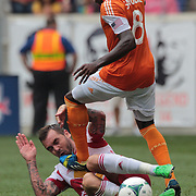 Jonathan Steele, New York Red Bulls, is fouled by Kofi Sarkodie, Houston Dynamo, who was booked for the challenge during the New York Red Bulls V Houston Dynamo Major League Soccer regular season match at Red Bull Arena, Harrison, New Jersey. USA. 30th June 2013. Photo Tim Clayton