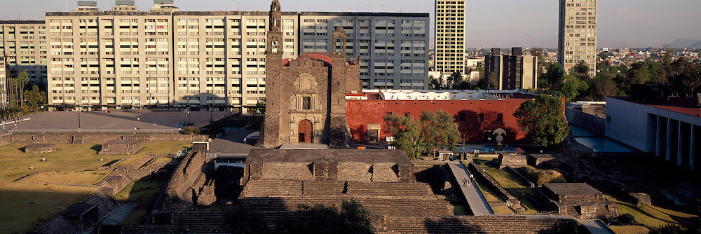 MEXICO, MEXICO CITY Plaza of Three Cultures with Aztec Temple of Tlatelolco, 17thC church of Santiago and modern government buildings