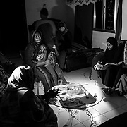 KHARTOUM, SUDAN - DECEMBER 14: The Akasha family spends time in the dark during a power outage in Khartoum, Sudan on December 14, 2020. Byron Smith for Libération