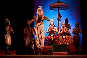 "During a performance of the Indian epic the Ramayana Ganga Thampi (center), plays the role of Sita the wronged wife of the exiled King Rama. She is both teacher and one of the stars of  the traditional and highly prestigious Kalakshetra school for the arts, Chennai. The school was founded in 1936 and due to its exacting and demanding schedule is considered India's formost classical dance academy of this ancient cultural art heritage that is informally known as ""temple dancing"" and that dates back to the Natya Shastra, the 2000 year old text that lays down the principles of Indian dramatic theory and performance. Tamil Nadu, India."
