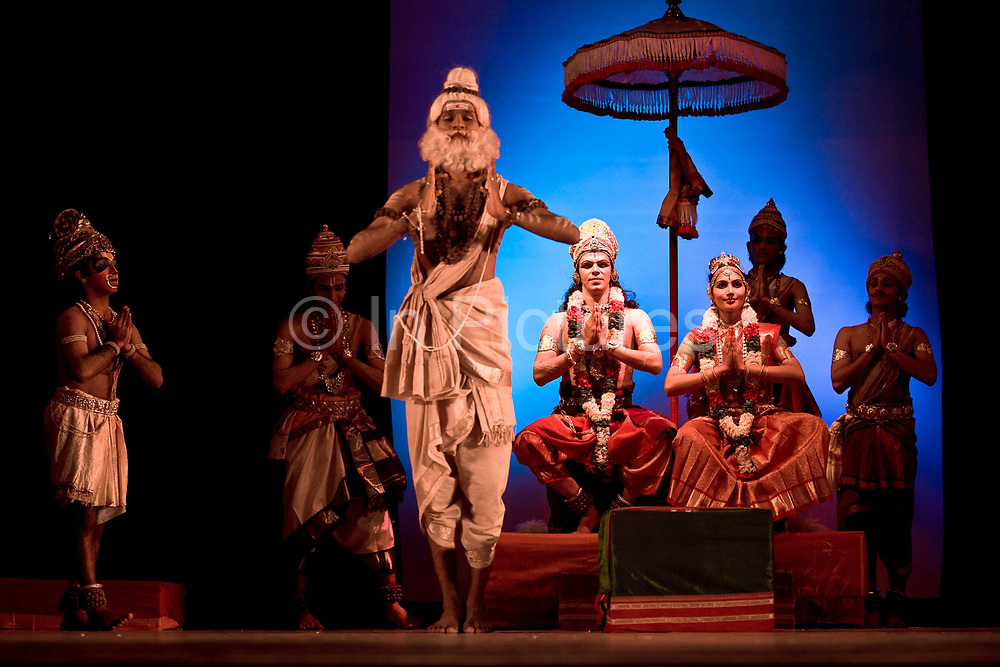 """During a performance of the Indian epic the Ramayana Ganga Thampi (center), plays the role of Sita the wronged wife of the exiled King Rama. She is both teacher and one of the stars of  the traditional and highly prestigious Kalakshetra school for the arts, Chennai. The school was founded in 1936 and due to its exacting and demanding schedule is considered India's formost classical dance academy of this ancient cultural art heritage that is informally known as """"temple dancing"""" and that dates back to the Natya Shastra, the 2000 year old text that lays down the principles of Indian dramatic theory and performance. Tamil Nadu, India."""