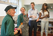 ***EMBARGO 12.01AM Tuesday 17 June.*** © Licensed to London News Pictures. 12/06/2014. Wallington, UK. Lorraine Pascale and Nick Clegg talk to staff in the school's kitchens.  Ahead of an announcement on new food standards for schools, Deputy Prime Minister Nick Clegg and celebrity chef Lorraine Pascale visit Foresters Primary School where they picked fruit with schoolchildren from the school's vegetable patch, prepared a fruit salad, helped the school chefs to serve food and sat with the children as they ate lunch. Photo credit : Stephen Simpson/LNP