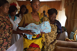 A relative holds a deceased newborn child, as the family prepares for a proper burial in Juba, South Sudan. The newborn baby's mother, Huuraida Hindi Bojo, suffered from malaria during her pregnancy, leading to a complicated pregnancy and the ultimate death of her newborn twins, which were born premature. Malaria is a leading cause of death in the country, with pregnant women and children especially vulnerable to the disease.