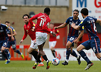 Football - 2020 / 2021 Sky Bet League Two - Morecambe vs. Bradford City<br /> <br /> Carlos Mendes Gomes of Morecambe puts through Cole Stockton who puts Morecambe 2-0 ahead, at the Mazuma Stadium.<br /> <br /> COLORSPORT/ALAN MARTIN