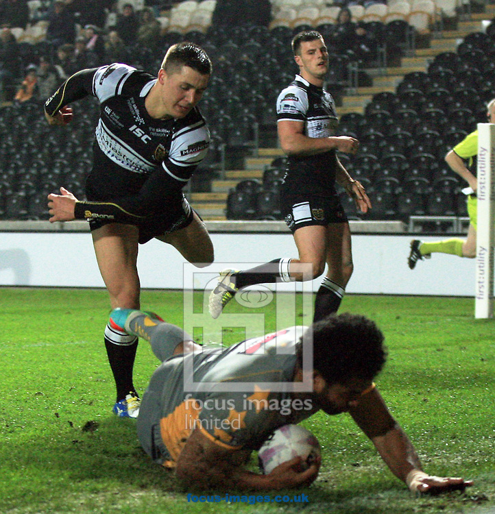 Jamie Shaul (left) of Hull Football Club can't stop Francis Meli of Salford Red Devils from scoring a try during the Tetley's Challenge Cup match at the KC Stadium, Kingston upon Hull<br /> Picture by Richard Gould/Focus Images Ltd +44 7855 403186<br /> 03/04/2014