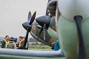 Re-enactors in World War II uniforms on the flight line with Spitfires and Hurricanes - The Duxford Battle of Britain Air Show is a finale to the centenary of the Royal Air Force (RAF) with a celebration of 100 years of RAF history and a vision of its innovative future capability.
