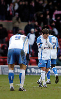 Photo: Leigh Quinnell.<br /> Nottingham Forest v Swindon Town. Coca Cola League 1. 25/02/2006. Swindons Jamie Cureton(R) and Lee Peacock show the pain of the 7 goal loss.