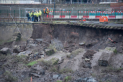 "© Licensed to London News Pictures. 24/01/2020. Bristol, UK. Engineers examine a stretch of collapsed wall and pathway by the river Avon on Cumberland Road in Spike Island, Bristol. The cycle path between the river and the road, known as the ""Chocolate Path"" because the square cobbles look like chocolate blocks, has been closed for two years since December 2017 due to subsidence but no work had been done though funding had been established. It is reported that Cumberland Road, which is a major bus route, will remain closed for the foreseeable future which will cause further issues with Bristol's already congested traffic. Photo credit: Simon Chapman/LNP."