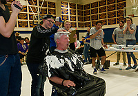 """A whipped cream slam dunk was given to Steve O'Riordan by Kenny Linkkila during the """"Pie a Teacher fundraiser to benefit The Doorway at LRGH on Friday afternoon at Gilford High School.  (Karen Bobotas/for the Laconia Daily Sun)"""