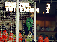 Photograph: Scott Heavey.<br />Arsenal v Tottenham Hotspur. FA Barclaycard Premiership. 08/11/2003.<br />Kasey Keller picks the ball out  of the net after seeing Freddie Ljungberg's shot deflect over his head