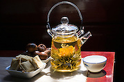 Flower infused tea and traditional snacks in the Huxinting Teahouse, Yu Garden Bazaar Market, Shanghai, China