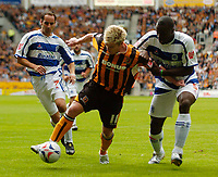 Fotball<br /> Foto: SBI/Digitalsport<br /> NORWAY ONLY<br /> <br /> Hull City v Queens Park Rangers<br /> Coca Cola Championship.<br /> 06/08/2005.<br /> <br /> Hull's Steve McPhee (C) holds off QPR's Danny Shittu