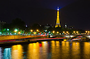 The Eiffel Tower at night from the Seine River, Paris, France
