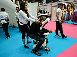 © Licensed to London News Pictures. <br /> 01/10/2017 <br /> Manchester, UK.  <br /> <br /> A woman offers a neck massage at a stand during the Conservative party Conference held in the Manchester Central Convention Complex.<br /> <br /> The conference will offer a schedule of speeches, receptions and fringe events giving a chance for party members and the public to learn about party ideas and policies for the year ahead.<br /> <br /> Photo credit: Ian Forsyth/LNP