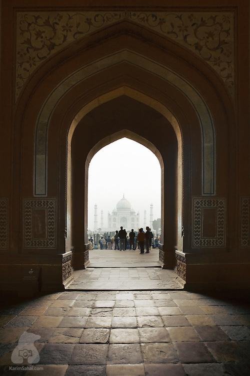 Tourists at the Taj Mahal's main gate, Agra, Uttar Pradesh, India.