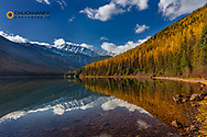 Great Northern Mountain reflects into Stanton Lake in autumn in the Flathead National Forest, Montana, USA