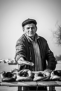 A Turkish man extends a popular local bread product in Istanbul, Turkey. (January 2, 2013)