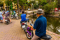 An Uber driver (in Vietnam, they drive motorcycles), Hanoi, northern Vietnam.