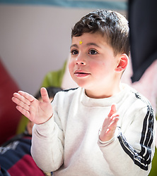17 February 2020, Zarqa, Jordan: A boy claps his hands in 'the nanny room' at the Lutheran World Federation community centre in Zarqa. Through a variety of activities, the Lutheran World Federation community centre in Zarqa serves to offer psychosocial support and strengthen social cohesion between Syrian, Iraqi and other refugees in Jordan and their host communities.