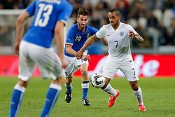 Theo Walcott of England is challenged by Mirko Valdifiori of Italy - Photo mandatory by-line: Rogan Thomson/JMP - 07966 386802 - 31/03/2015 - SPORT - FOOTBALL - Turin, Italy - Juventus Stadium - Italy v England - FIFA International Friendly Match.