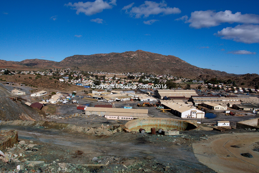 NABABEEP, South Africa - 7 July 2014 - A view over the sleepy town former copper mining of Nababeep in South Africa's Northern Cape Province. The mine closed in 2004 and the old mining buildings, seen here in the foregound, were once part of the mine complex, are now used by small businesses, such as auto mechanics. Picture: Giordano Stolley