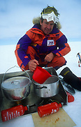 Melting snow for cooking, dog sledging and skiing across Greenland icecap, Arctic