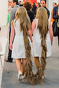 Siamese Hair Twins, A walking installation, by Tunga - Frieze London 2015, Regents Park, London. Frieze London is one of the few fairs to focus only on contemporary art and living artists. The exhibiting galleries represent the most 'exciting' contemporary galleries working today. The focus on living artists is also evident in the critically acclaimed Frieze Projects' programme. The fair presents a curated programme of talks, artists' commissions and film projects, many of which are interactive or performative and encourage visitors to engage with art and artists directly. The fair is open to the public 14–17 October.