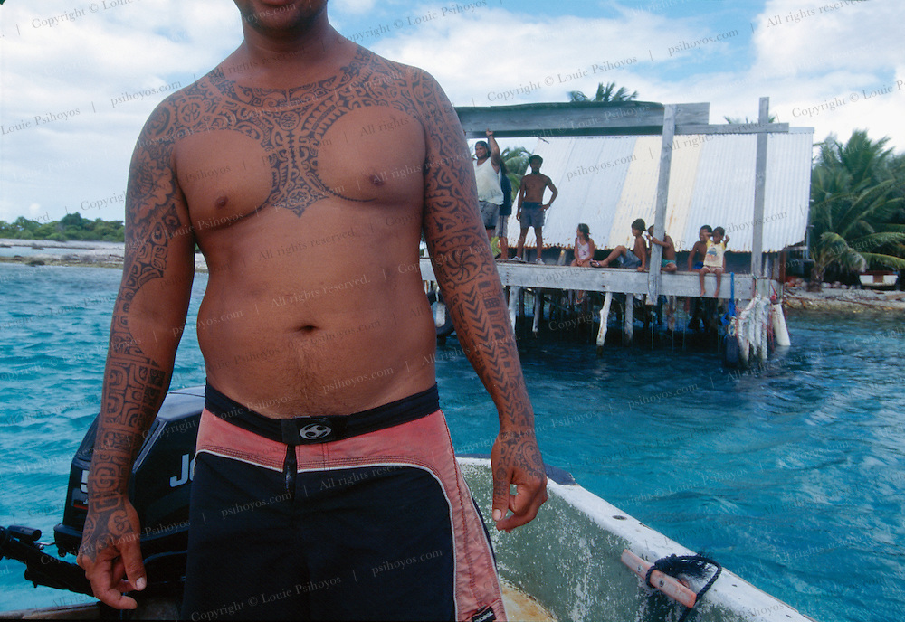 Diver at pearl farm in Manihi with tattoos.