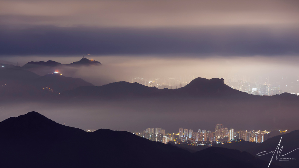 The symbolic mountain of Hong Kong, The Lion Rock, covered in a sea of cloud, resulting in this poetic image.