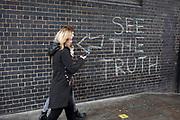 See the truth graffiti on Brick Lane in London, United Kingdom.