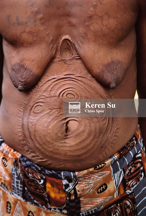 Tattoo pattern on Sepik River woman's body made by worms, Upper Sepik river, Papua New Guinea