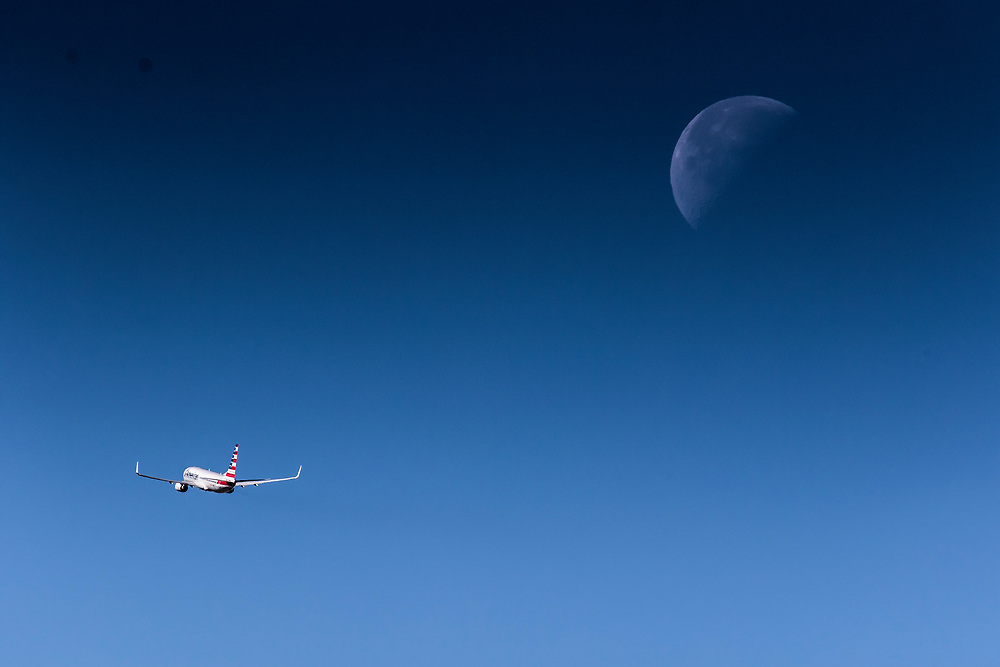 Dec. 10, 2017: An American Airlines B737 departs Miami International Airport as the Third Quarter Moon sets in the west.