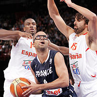 15 July 2012: Victor Sada of Team Spain defends on Tony Parker of Team France during a pre-Olympic exhibition game won 75-70 by Spain over France, at the Palais Omnisports de Paris Bercy, in Paris, France.